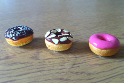 Three colourful donuts in a row