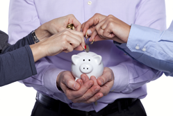 People holding a piggy bank
