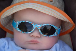 Sleeping baby wearing sunglasses