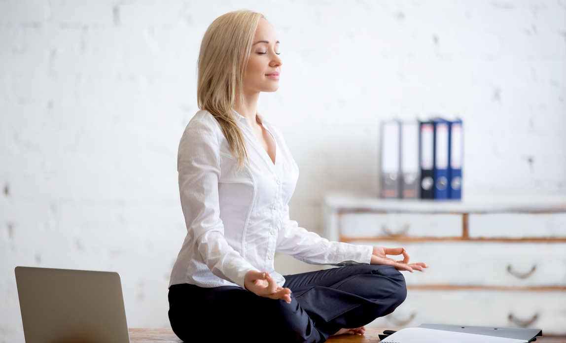 Woman meditating - How to create a positive culture in your start-up