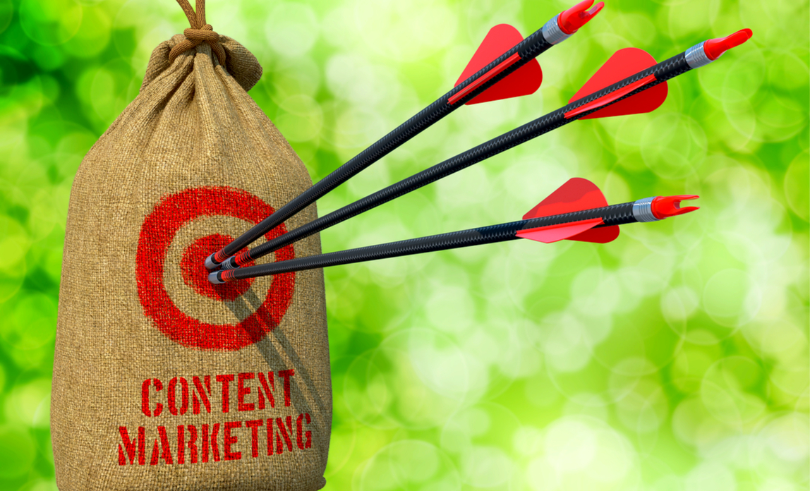 3 arrows hitting a target with content marketing written on it.