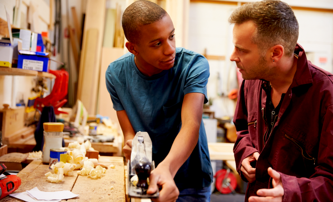 Young man being mentored - how to hire an apprentice