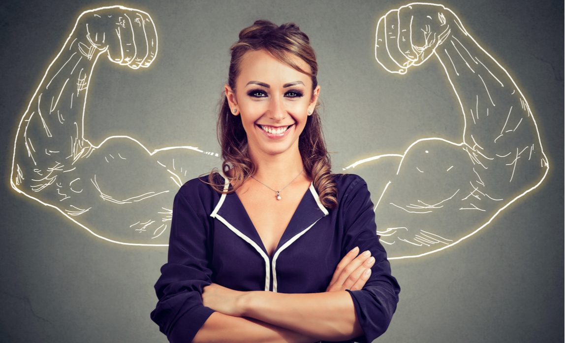 Happy woman building a strong business, grey background