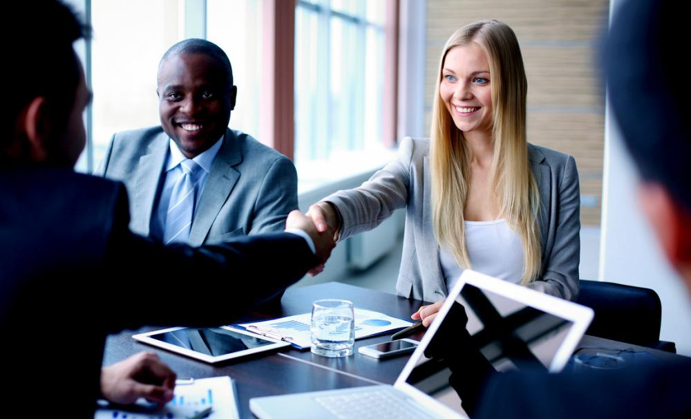 Shaking hands at a meeting - business partnerships