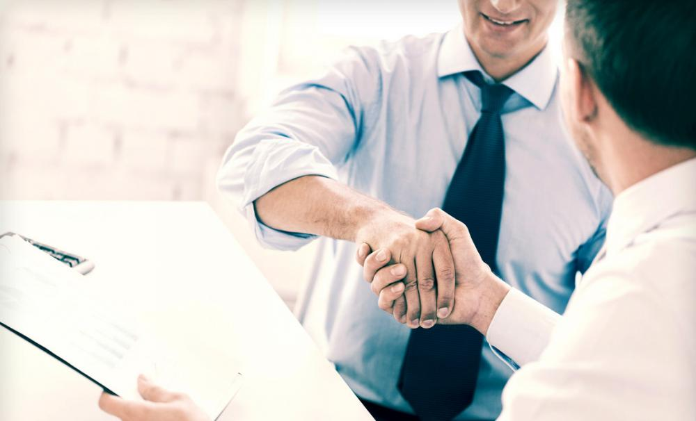 Two men shaking hands - buying a business