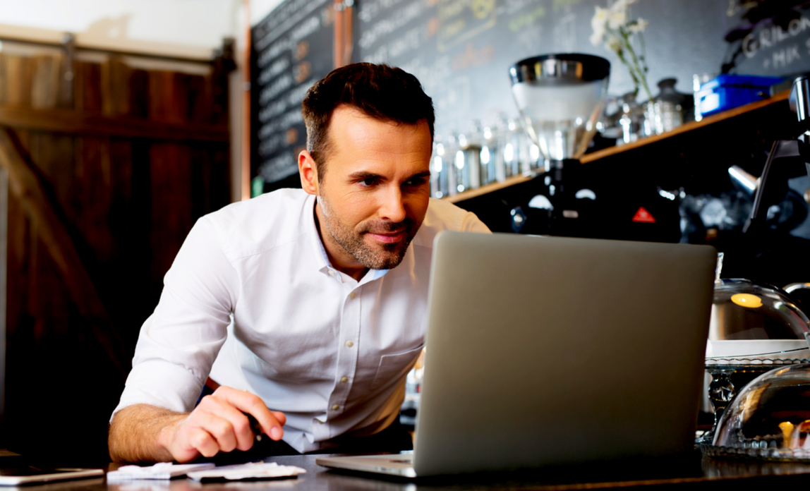 Man using laptop - could you franchise your business?
