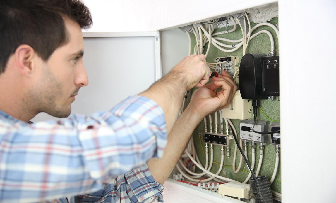 Electrician fixing a power box