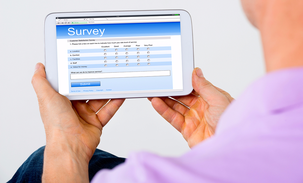 Marketing manager creating an effective customer questionnaire on a tablet