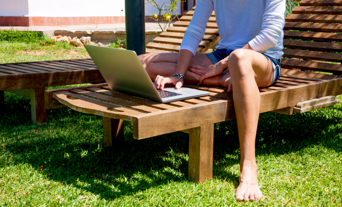 On laptop outside - run your business from anywhere