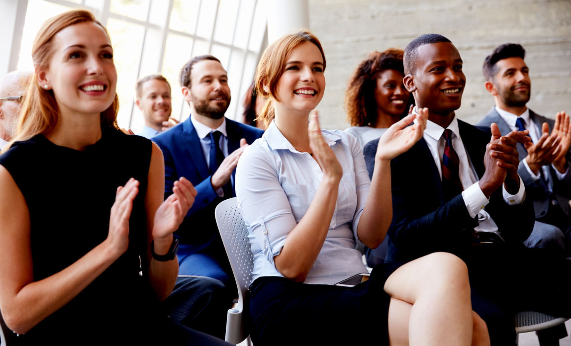 Audience applauding - how to win over your audience.