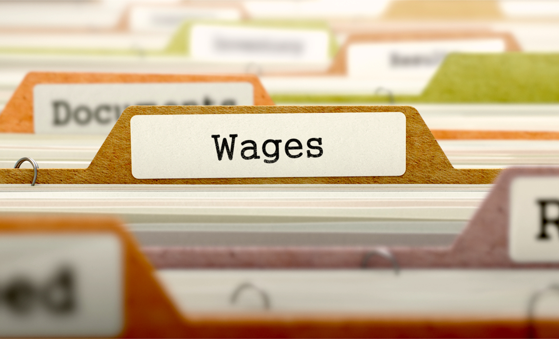 Wages folder in a cabinet - minimum wage and statutory pay obligations