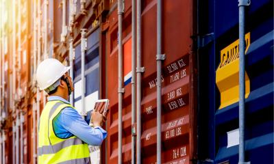 A port controller inspects shipping containers
