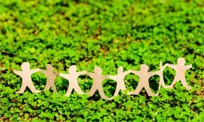 Human chain paper on green creeper plant to represent CSR (corporate social responsibility)