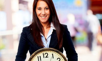 woman with clock - get more from your working day