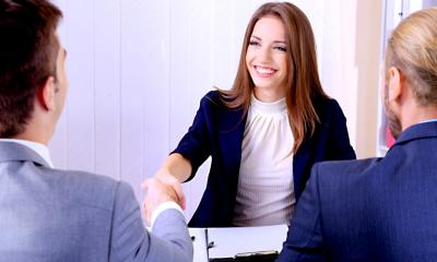 Smiling woman shaking hands - how to recruit a star performer