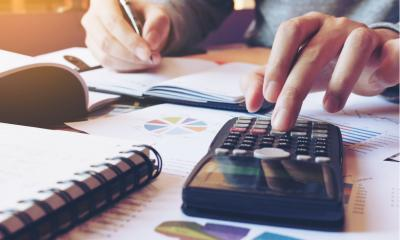 Businessman performing payroll calculations