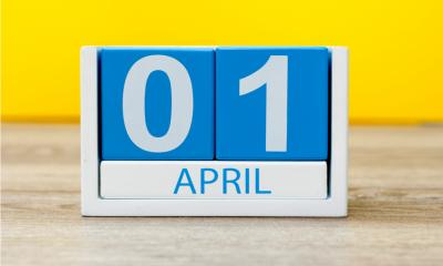 April 1st. Day 1 of april month, calendar on yellow background.