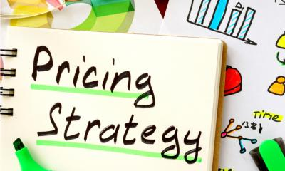 A note pad with the words Pricong strategy written at the top