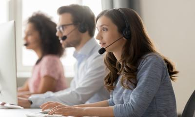 Call centre handlers answer calls from businesses concerned about the impact of coronavirus