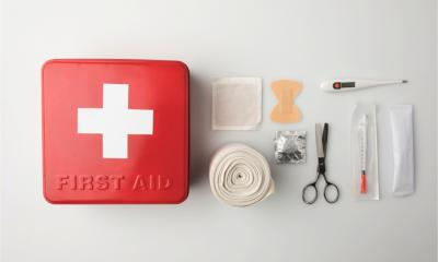 Top view of first-aid kit representing the aid and support available to struggling businesses during the COVID-19 outbreak rmometer and elastic bandage