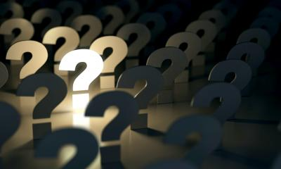 A row of question marks representing market research