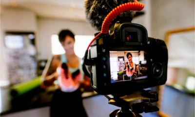 A female entrepreneur films her tips and advice via video