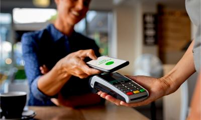 A customer pays for goods using contactless technology