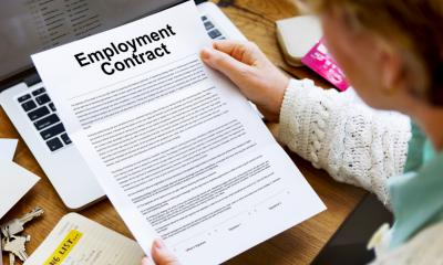 Woman reading an employment contract - Q&A: Statements of employment