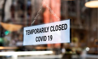 'Temporary closed COVID-19' sign outside small independent coffee shop in London