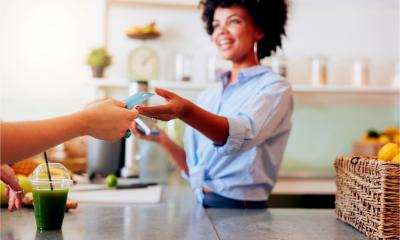 A female employee takes a card payment from a customer