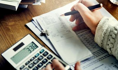 Business person performing VAT calculations