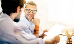 Smiling man during business meeting with his co-founder