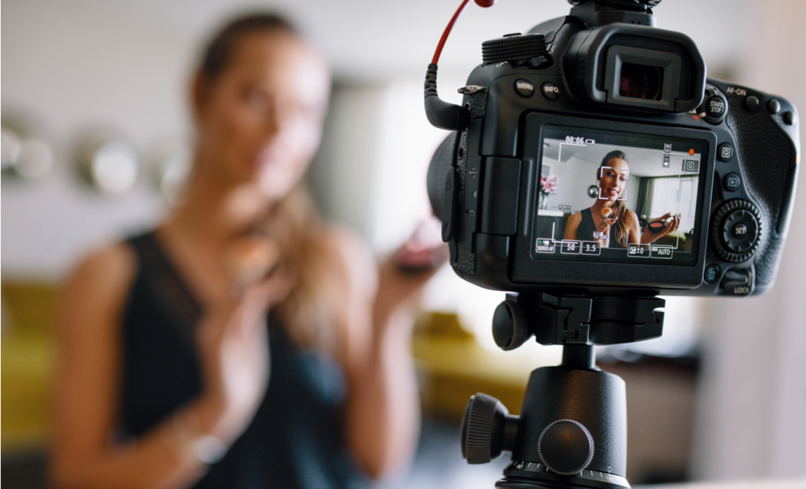 A woman is recording a video marketing message for her website
