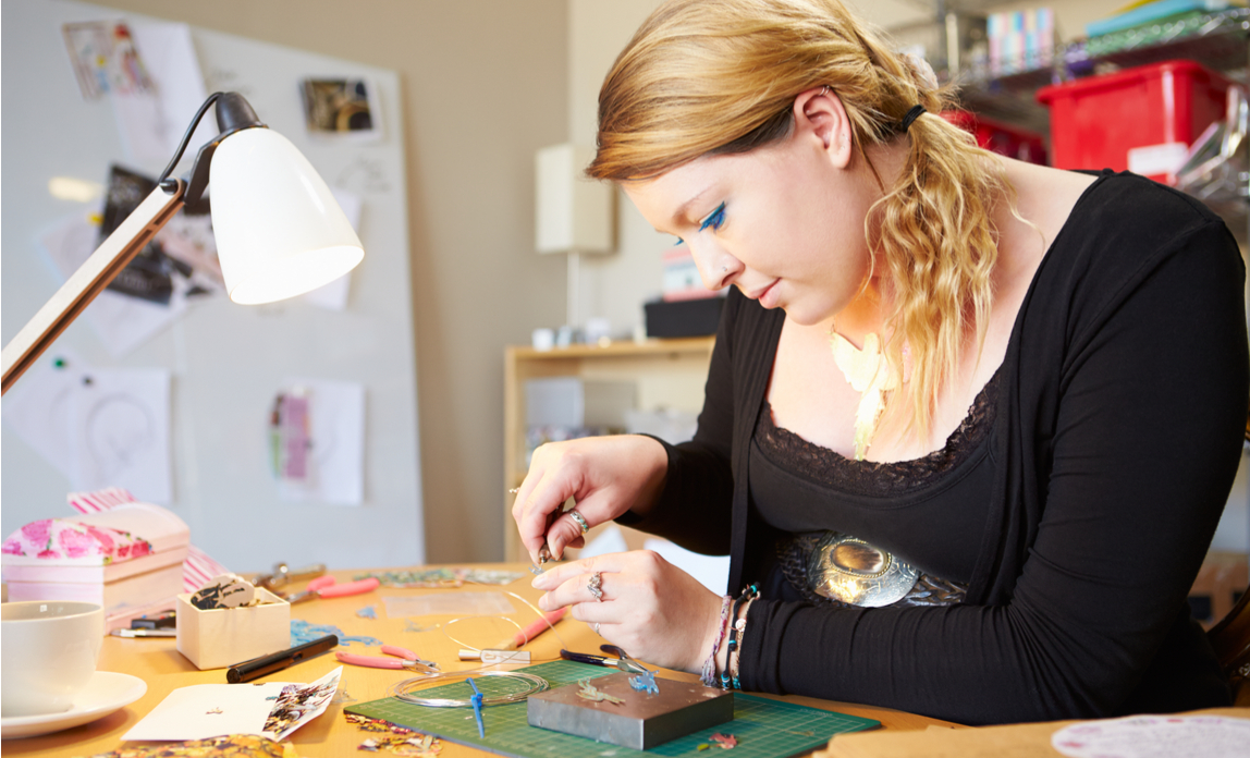 Woman creating her own products for sale as an additional source of income