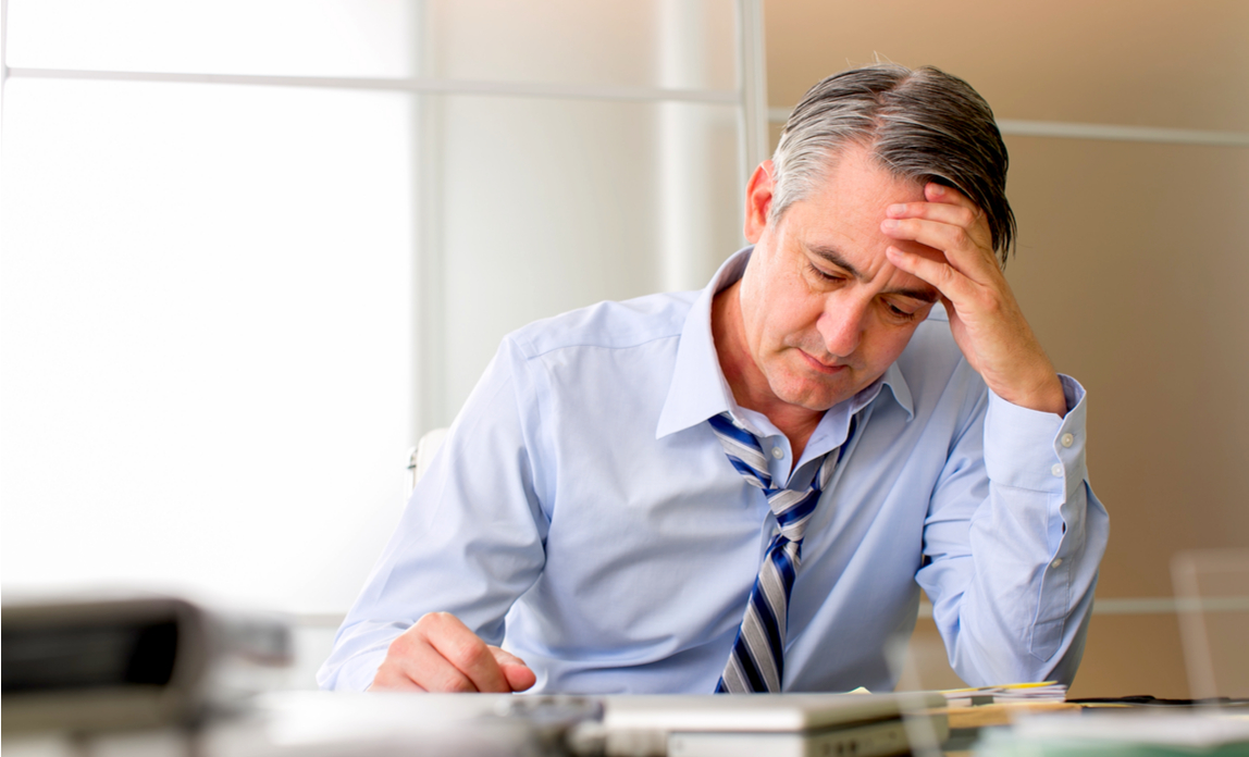 A business owner looks frustrated and confused about new payroll reforms